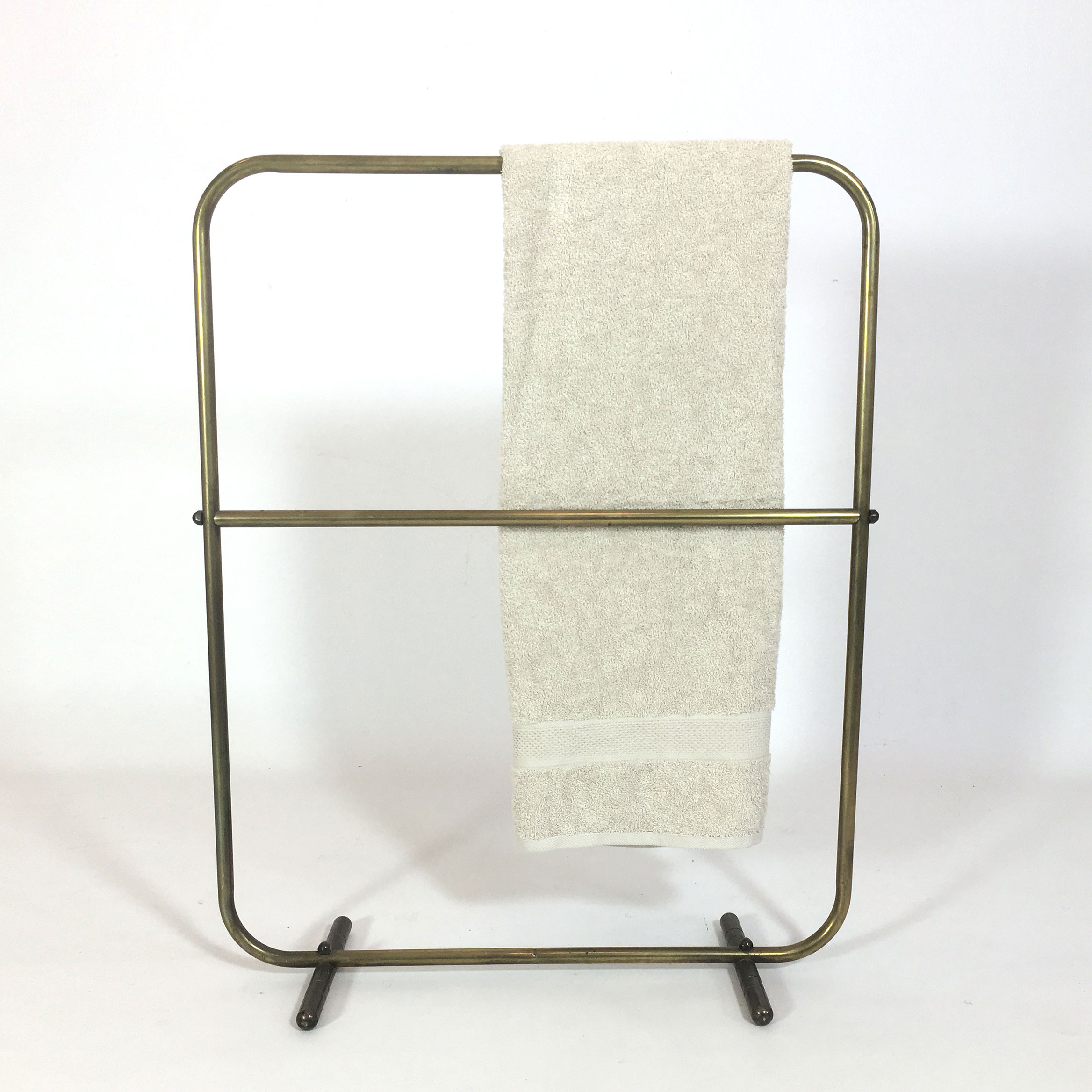 Brass towel track.