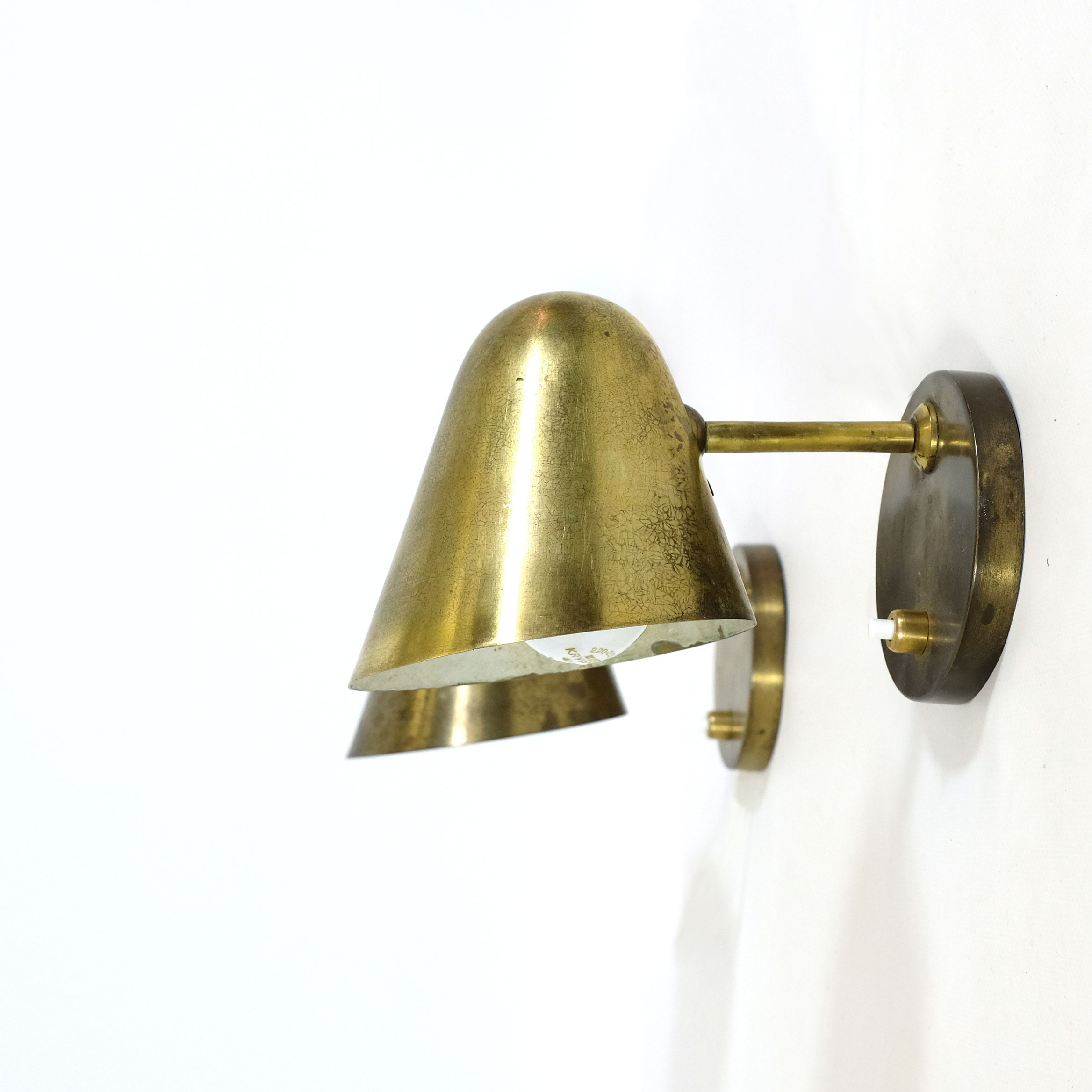 Pair of brass wall mounted lamps from the 1950's.