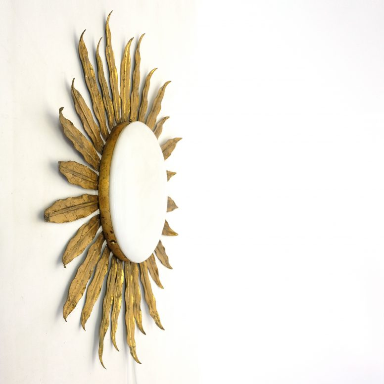 Large Italian sun shaped wall lamp from the seventies.