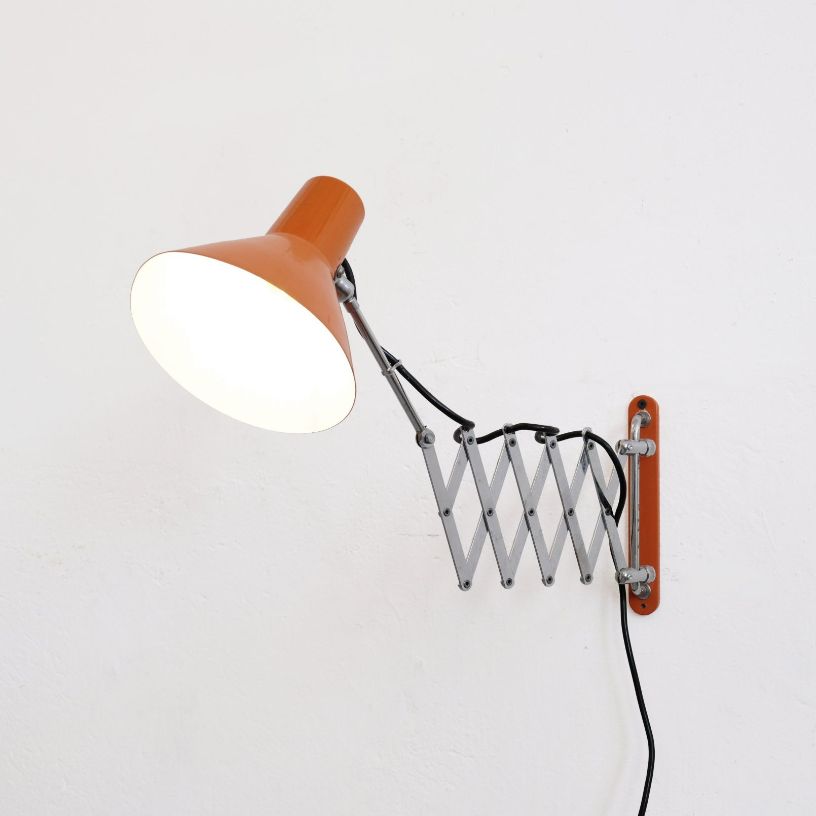 Orange wall mounted scissor lamp, 1970's-1980's.
