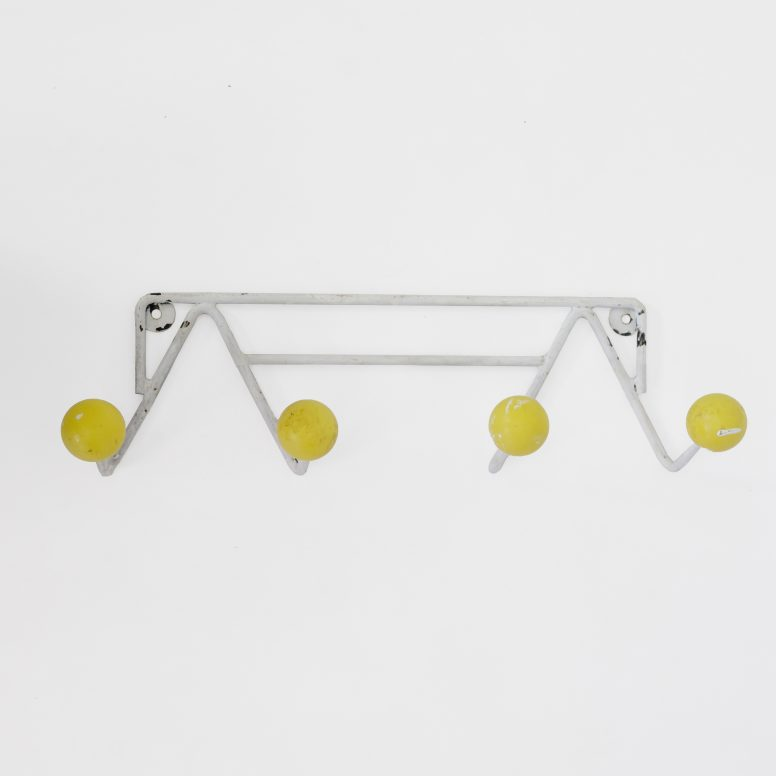 Yellow coat rack from the 1960s-1970s.