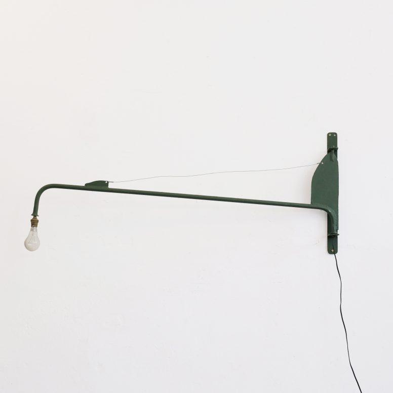 Handcrafted swing jib wall lamp.