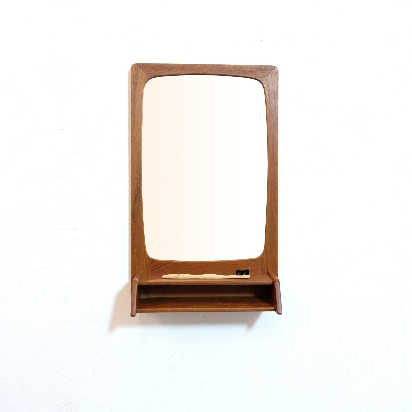 Scandinavian teak mirror with a shelf, 54x33 cm.