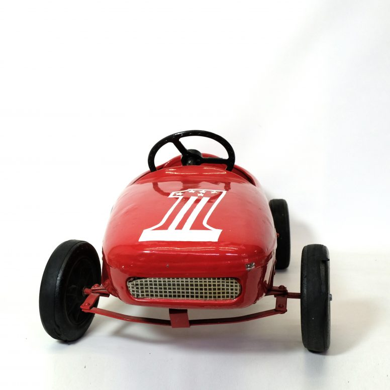 Red child's race car from the 1950s-1960s.