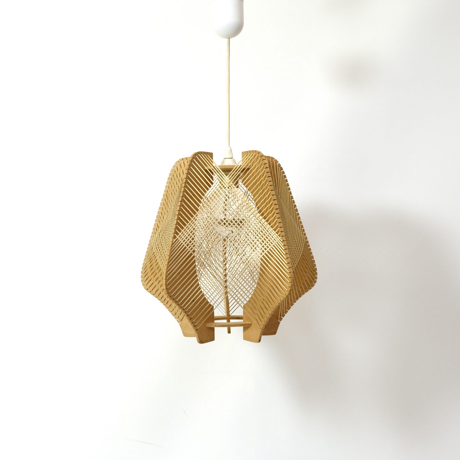 Vintage wood and string pendant from the 1960s-1970s.