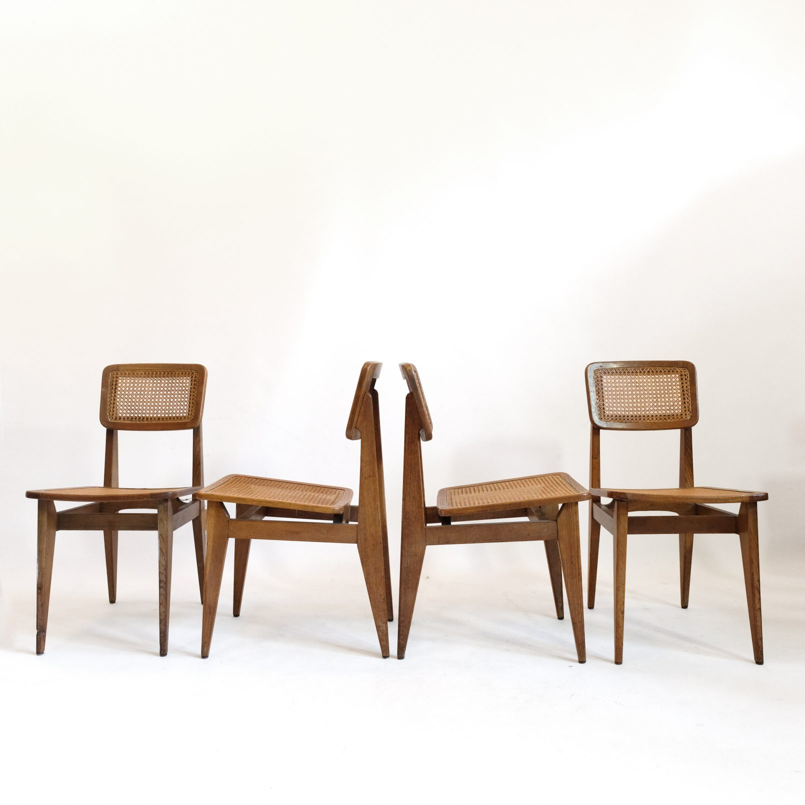 Marcel Gascoin, set of 4 C cane chairs, Arhec, 1950's.