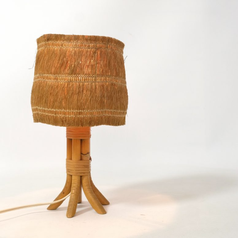 Little table lamp with a braided shade.
