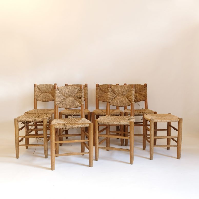 Set of six chairs and two stools by Charlotte Perriand.