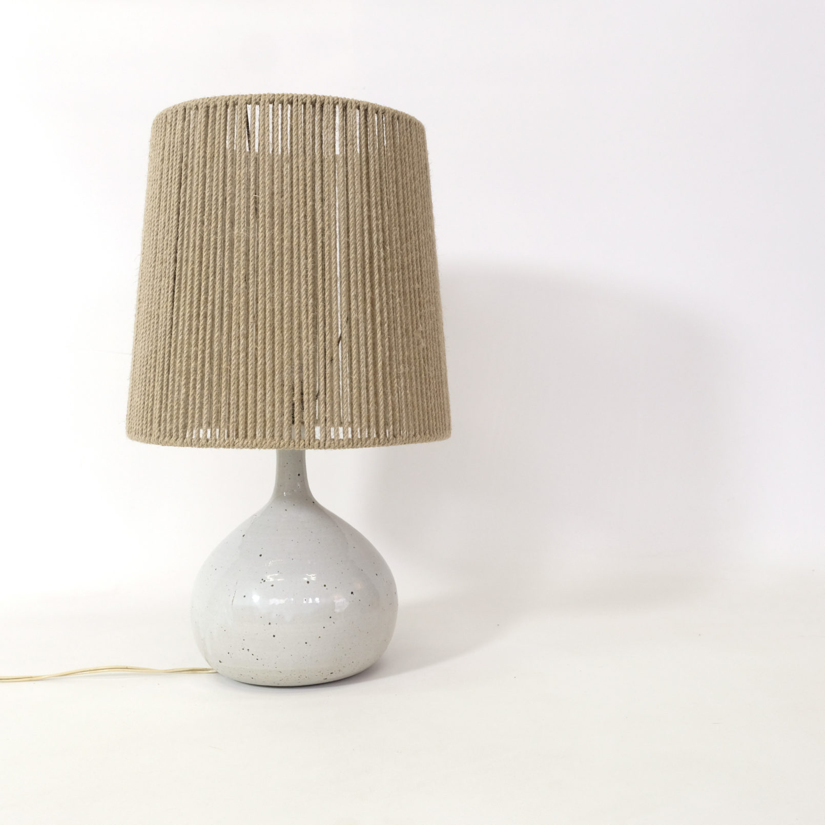 Table lamp with a white earthenware base, 1960s.