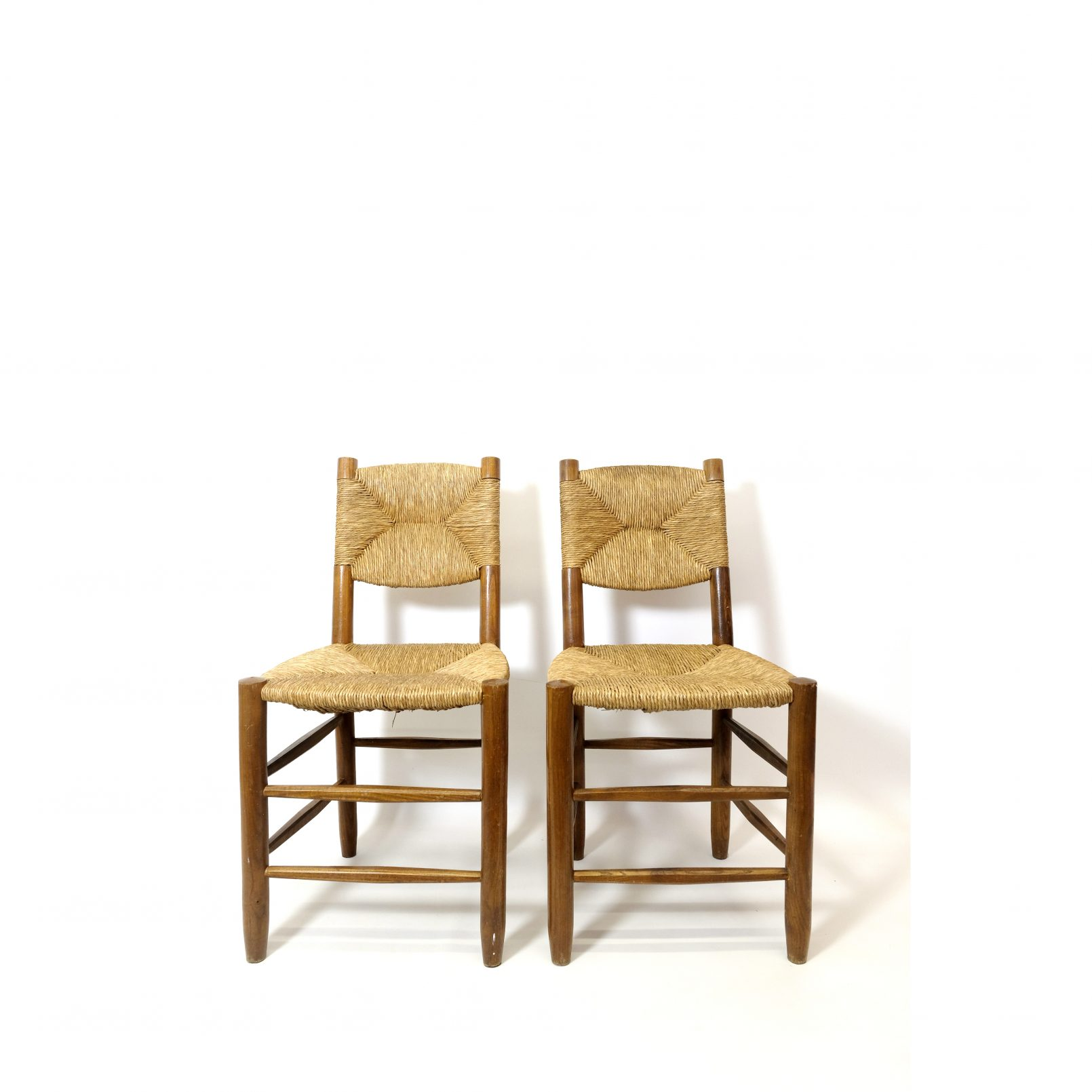 Charlotte Perriand, a pair of chairs n°19, design of 1939.