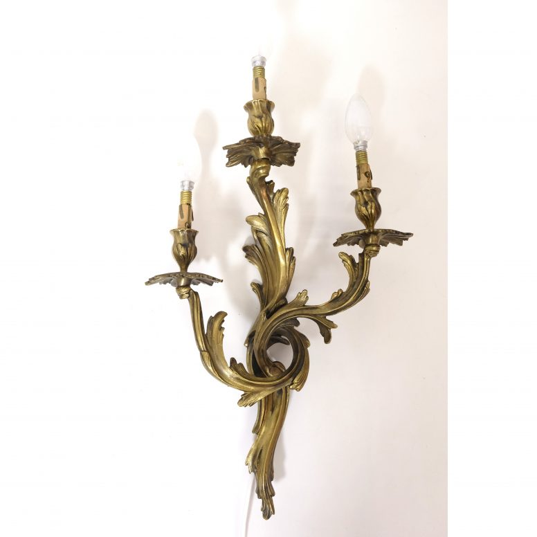 Large classical wall lamp with three lights.