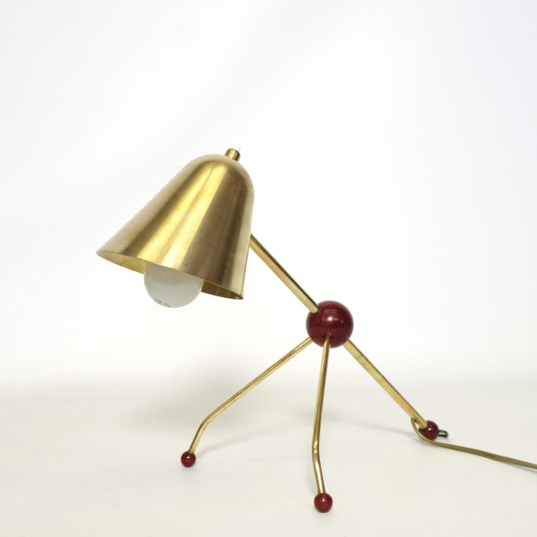 Otto Kolb, brass and red Bakelite lamp, 1950s.